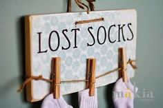 """Cover up an ugly spot on the wall with a """"Lost Socks"""" board. 