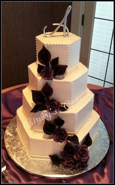 Cindy's Cakery // hexagon wedding cake in buttercream with purple gumpaste calla lilies and roses // www.cindyscakery.com