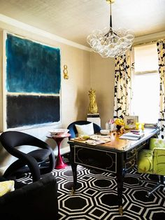 feminine yet formal home office with a bubble chandelier large art and a black