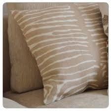 svenskt tenn zebratyg som alt. till röda stolarna. Finns att beställa via kundservice.