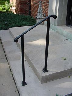 Simple, elegant wrought iron railing, no pickets, cast iron scroll ends. Outside Stair Railing, Porch Step Railing, Porch Handrails, Exterior Stair Railing, Outdoor Stair Railing, Front Porch Railings, Iron Handrails, Porch Steps, Front Steps