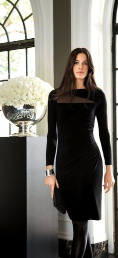 This contemporary long-sleeved Lauren Ralph Lauren dress features stylish angled sheer panels at the