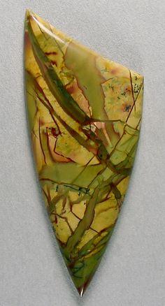 Morrisonite cab, Silverhawk's designer gemstones.