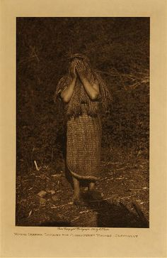 volume 11  facing: page  58 Woman shaman looking for clairvoyant visions - Clayoquot