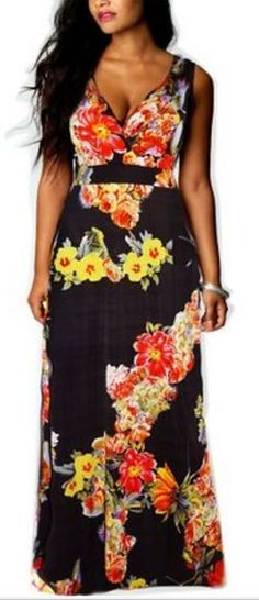 Plus size tropical print maxi dress with high waist line. Warm color maxi dress