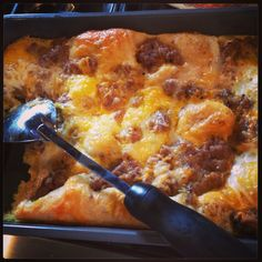 Easy breakfast casserole - eggs, sausage, cheese, and crescent rolls. Includes instructions for high altitude.