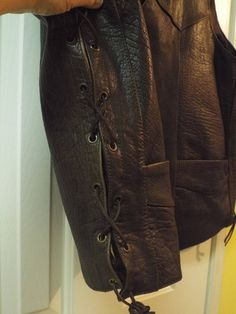Mens vintage leather biker vest by Vance Leathers. This size 52 motorcycle vest is great for taking a long bike ride on a summers day. It has leather ties up the sides. In very good used vintage condition. I love the varying shades of brown leather that melds together. Snap front. Size 52 50 chest 50 waist 28 at longest point  Please feel free to ask any ?s that you may have about the item or the shipping costs. Thanks.
