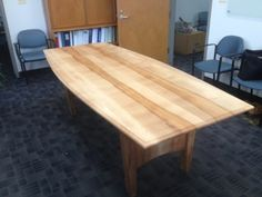 Beech conference table using the heartwood as a design accent