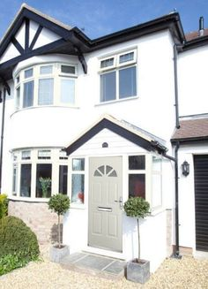 Entrance porch on semi-detached house with round bay windows- reminds me of my childhood. Porches can make a difference. Porch Uk, House Front Porch, Front Porch Design, House Entrance, Porch Designs, Front Porches, Entrance Doors, Porch On Semi Detached House, Style At Home