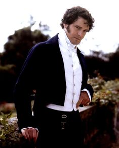 Mr. Darcy from Pride and Prejudice. Mr. Darcy's attire is an example of dandy dress because it is fashionable, sophisticated, and simplistic.