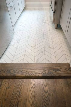 Don't' you love how perfectly paired these floorings are together? White porcelain chevron tile floor from @stonepeakceramics with custom wood flooring in dark walnut & Jacobean stain. #PaulaMcDonaldDesignBuild #chevrontile #smallspace #whitekitchen#kitchendesign #galleykitchen - - - - Another Prewar, Jr 4 - E 68th St, NYC #kitchendesignnyc