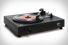 driven via Micro USB, the nifty spinbox cardboard record player can easily switch from 33 to 45 to 78 RPM and plays and singles. Vinyl Record Player, Vinyl Records, Diy Turntable, Kit Diy, Home Tech, Retro Futuristic, Audio, Intelligent Design, Diy For Girls
