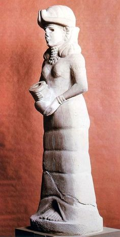 Goddess with flowing vase (probably Ishtar) found in Mari. ca. 1800. Syria.