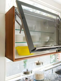 For a cabinet is tucked into a tight corner, use a vertical hinge to avoid banging the door into the wall. Go up and out!