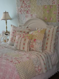 Love this cottage..vintage style bedding.  love the matching quilt hung over bed........jeje