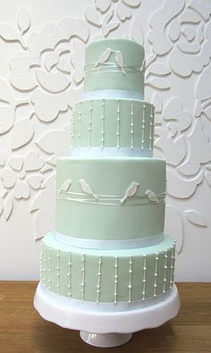 Lovebird Four Tier Wedding Cake, in the perfect shade of grayed jade (mint) add fresh white blooms at the bottom for a finishing touch Orlando wedding flowers / www.weddingsbycarlyanes.com   Keywords: #mintweddings #jevelweddingplanning Follow Us: www.jevelweddingplanning.com  www.facebook.com/jevelweddingplanning/