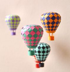 Woven paper hot air balloons. Make a mobile. Patterns included.