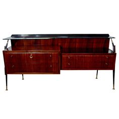 Stunning and elegant midcentury Silvio Cavatorta rosewood credenza with smoked glass top. Four drawers with brass knobes allow for great storage. Brass finish on the legs. Wall Desk, Metallic Paint, Credenza, Mid-century Modern, Mid Century, Indoor, Dining, Storage, Furniture