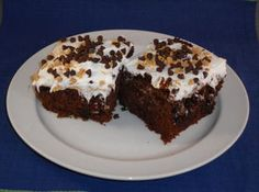 Julies Caramel Fudge Chocolate Cake:  1 pkg(18-1/4 ounces) chocolate cake mix  1/4 cminiature semisweet chocolate chips  1/2 jar(s)(12-1/4 ounces) carmel ice cream topping, warmed  1/2 jar(s)(11-3/4 ounces) hot fudge ice cream topping, warmed  1 can(s)store bought chocolate or vanilla frosting  1/2 cheath english toffee bits
