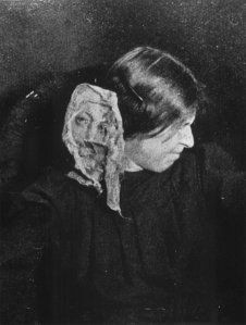 Medium Eva C., photographed 8 May 1912 by flashlight during production of face from ectoplasm.