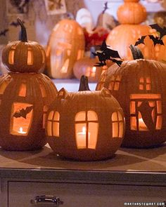 so whimsical - if only i had a week to devote to pumpkin carving : / oh martha, we can't all be you.