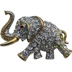 A Vintage signed Attwood & Sawyer Gold tone and pave set clear Swarovski crystals elephant figural brooch