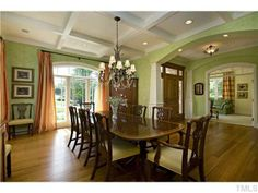 Traditional and classic dining room with an antique-like chandelier, boxed ceilings, and floor-to-ceiling windows. Raleigh, NC Coldwell Banker Advantage $1,695,000 dining rooms, box ceil, dine room, coldwell banker, floortoceil window, decad dine, classic dine, coldwel banker