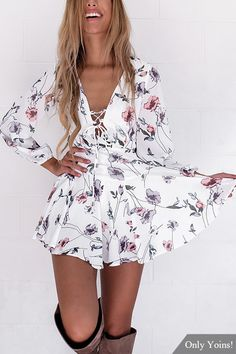 Stand out in the crowd with this mini dress. You will fall in love with it. Featuring random floral print, elastic cuffs long sleeves, lace-up front and hidden zip back. Style it with high heels or sandals is great.