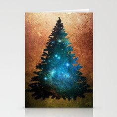 """Yuletide Universe Stationery Cards showing a Christmas tree """"decorated"""" with stars and nebula on a distressed background"""