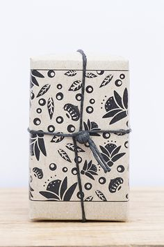 Natural soaps wrapped in recycled patterned papers and tied with black hemp string.