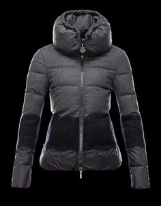MONCLER Jacket made of a mixture of materials: flannel, nylon and wool. Rain System treatment guarantees rain-resistant performance. Logoed zip puller enameled in matching color.