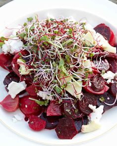 Beet Salad with Goat Cheese, Green Apple, and Honey | Martha Stewart Living - You can never go wrong with a beet and goat cheese salad. This one has a light lemon-honey dressing and a crown of delicate microgreens (or sprouts if you prefer).