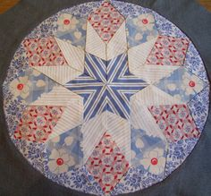 this one has been set into the chosen background fabric Circle Quilts, Star Quilts, Mini Quilts, Square Quilt, Quilt Blocks, Quilting Projects, Quilting Designs, Snowman Quilt, Antique Quilts