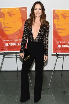 Olivia Wilde in a Michael Kors lacy jumpsuit | November 27, 2015