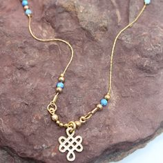 Necklace with double infinity pendant and opals by MaYaJEWELRYDESIGN on Etsy https://www.etsy.com/listing/239310089/necklace-with-double-infinity-pendant