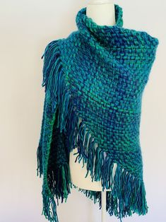 Comfortable and warm hand made shawl. Made with a blue to green soft yarn. Neck border is separately sown using a light green to give it a more unique look.Blue Lagoon