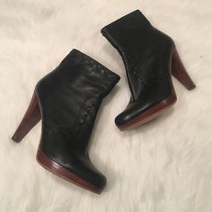 GUESS Booties Black and brown GUESS Booties with a weaving design that goes over the front and around the top or the ankle. With a higher or 4 inches these are perfect for a night out on the town or a day stuck in the office! Guess Shoes Ankle Boots & Booties