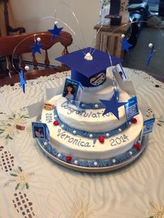 This is the graduation cake I designed and decorated for my daughters high school graduation. I used the smoothing method found on Pinterest (http://cakecentral.com/cake-decorating-ftopic-682196-0.html) ( no fondant ever in this house) and it worked beautifully!  The photos around the cake are a combo of the school year and a corresponding drawing she drew that year (yes, I'm a pack rat. But glad I am for this occasion).