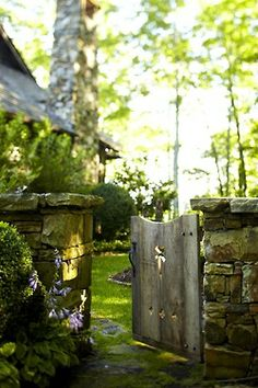 Pretty low stone wall and garden gate. Would love to have a walled-in veggie garden at the new place. Maybe we could make one out of cob with a cob pizza oven too. Dream Garden, Home And Garden, Garden Cottage, Jardin Decor, Photo Blue, Fence Gate, Porch Gate, Fencing, My Secret Garden