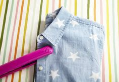 The quickest way to get rid of wrinkles in the areas between the buttons and on the collar of your top is to iron them with a hair straightener.