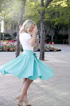 This is THEE most flattering skirt.  It has a removable bow that can be worn in the front and back-- in serious love over here!