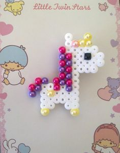 Perler beads with some sort of accent pearls on the top. Cute idea.