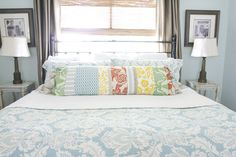long throw pillow: looks nice on the bed without the fussiness of lots of little pillows.