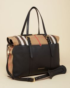 Burberry Mason Diaper Tote    Cotton/leather   Machine wash   Imported   Carry straps at top with adjustable buckles, removable and buckle-adjustable crossbody strap with shoulder pad   Exterior leath