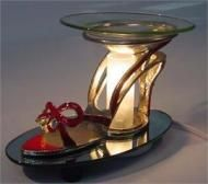 Price $25.99 - E65017R  Beautiful Electric oil warmer for your home, very classy decoration for any home. I now can also offer this shoe warmer as a Tea Light using the tea candles. The price for the Tea Light would be $19.95. So please let me know which one you prefer....