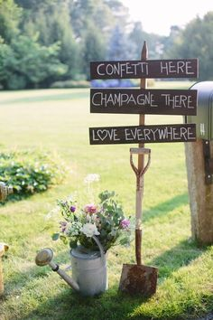 Watering canister filled with flowers & sign on shovel perfect for an elegant garden wedding theme   Photo credit: Catalina Ayubi http://catalinaayubi.com