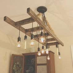 FREE SHIPPING! M & D Lighting Company offers our 4ft or 5ft primitive ladder chandeliers. Cozy up to the table and enjoy a meal with your loved ones under the light of our reclaimed ladder chandelier! With the soft amber glow of the edison bulbs and weathered ladder overhead, happy memories of a bygone era are sure to come to mind. Great for the dining room table, kitchen island, or pool table! Decorate ladder with greenery or vines for a custom farmhouse feel (please use caution). -Di...