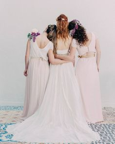 Etherial bridal beauties in @loho_bride and @joannaaugust with bold floral accents.|| Coordination: @dayofgal @gal__julia | Design & Florals: @revelpetals | Venue: EbellofLB @treslacatering | Photography: @lovebyhailley| Beauty: @stephanielashes @brittenfaithmakeup @makeupbyjessiex | Bridal Gown: @loho_bride | Bridesmaid Fashion: @joannaaugust | Head Piece: @heartofgolddesigns| Models: @juliemcniven @christinebarraco @alanakschoen