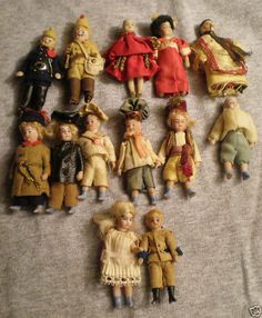 Collection of 2.5 inch all bisque dolls in original clothes.