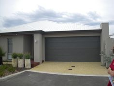 Like this look, wide gutters and colours, but maybe miniorb sectional door New Home Designs, Garage Doors, New Homes, Exterior, House Design, Colours, Outdoor Decor, Home Decor, New House Designs